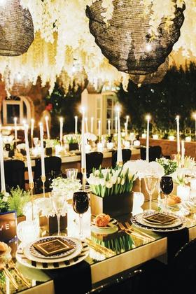 destination wedding decor mykonos greece black glassware goblets tulips gold table mirror top