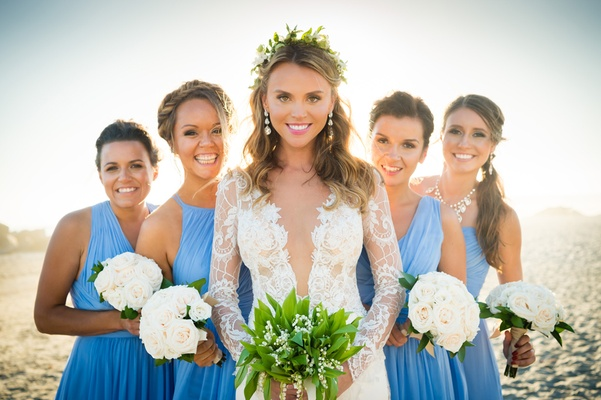 bride bridesmaids triangle pose spacing windows beach blue dresses white bouquets san diego