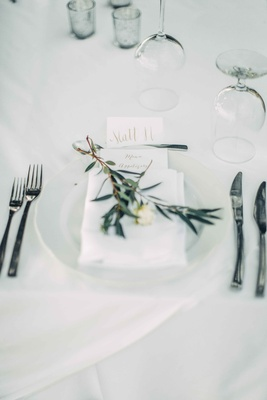 white and green place setting beach branch blooms calligraphy menu