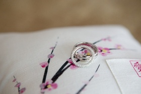 Wedding rings on cherry blossom print pillow