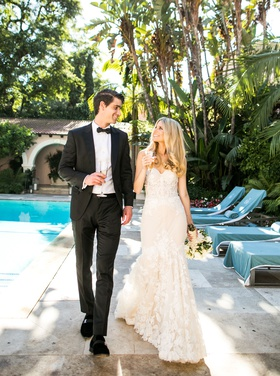 wedding portrait bride and groom at hotel bel-air pool with flute of champagne california wedding