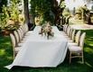 wedding reception garden setting white linen french upholstered chairs low garden centerpiece flower