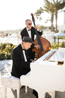 Wedding reception music cocktail hour ceremony prep tuxedo musicians white piano and bass