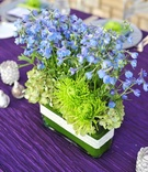 Crystal-wrapped rectangular vase with blue flowers