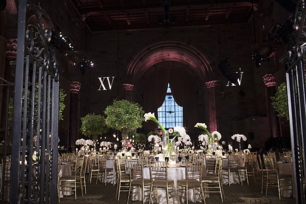 Wedding reception at Cipriani Wall Street with gold chairs, white orchids, calla lily bouquets