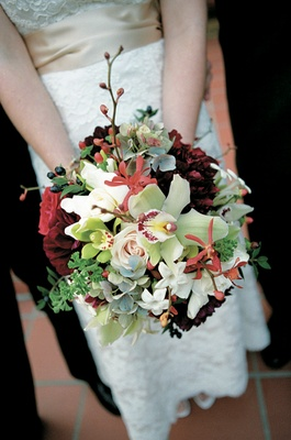 Hydrangea, orchid, rose, and dahlia wedding bouquet with rich colors