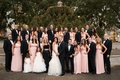 Bridesmaids in blush and groomsmen in tuxedos