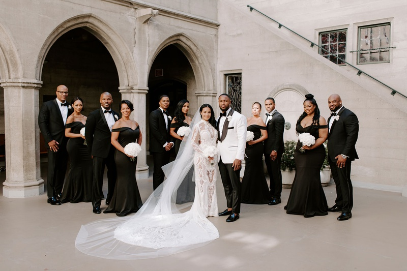 r&b singer Tank with groomsmen, jamie foxx and j. valentine, bridesmaids in black off-the-shoulder