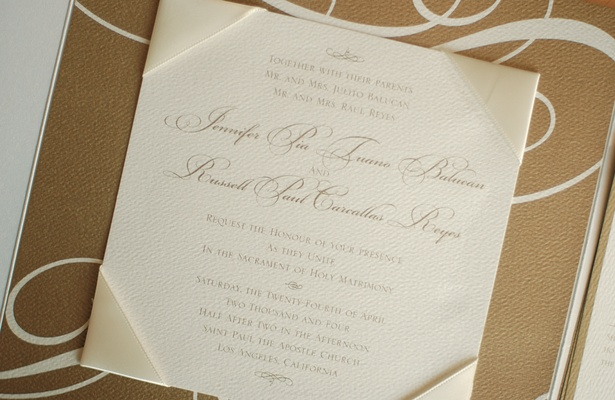 Wedding stationery with satin ivory corners on gold paper
