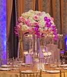 white hydrangeas, pink roses, purple orchids, wedding centerpiece, gold linens
