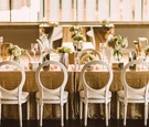 mint museum uptown wedding mirrored risers ivory flower arrangements