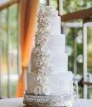 Round white wedding cake with sugar flowers