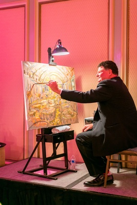 Vow renewal anniversary party with live event painter painting picture of ballroom tables on stage