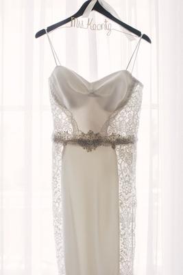Galia Lahav wedding dress with spaghetti straps, lace panels, beaded belt on personalized hanger