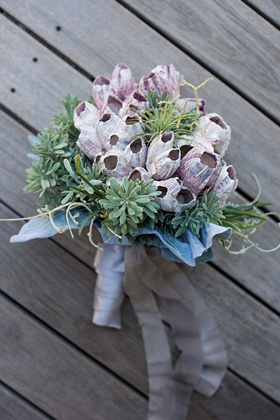 bridesmaid bouquet with barnacle cluster coastal succulent greenery ribbon