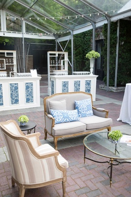 outdoor setting, blue and white wedding décor, srting lights pattern panels armchairs sofas