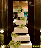 White wedding cake with green flowers