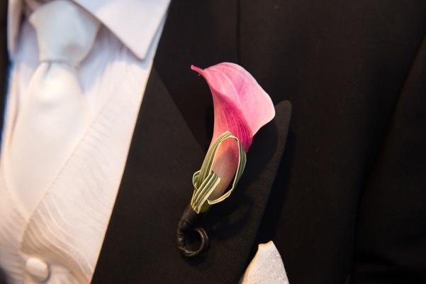 groom in vera wang with single pink calla lily for a boutonniere