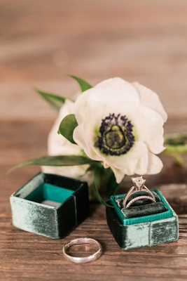 Emerald green ring box with engagement rings