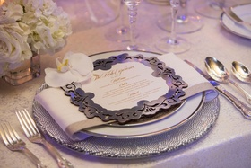 Wedding reception place setting silver laser cut menu card white orchid rose hydrangea centerpiece