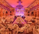 Lucite ceiling fixture in center of ballroom at The Plaza Hotel in New York City opulent wedding