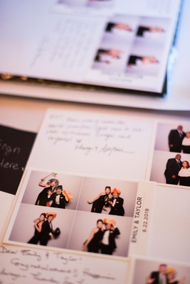 wedding reception guest book notes from friends and family with photo booth pictures in book