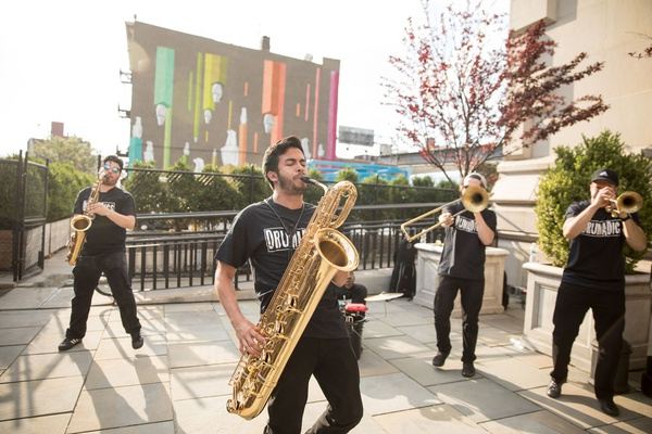 Wedding reception ceremony idea street band in brooklyn performing for guests who were early