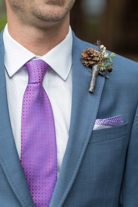 grooms blue suit purple tie pocket square rustic boutonniere patterns greenery