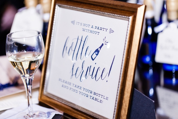 Gold frame with blue and white seating card sign