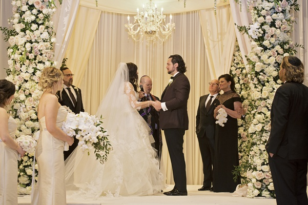 bride in vera wang ball gown, groom in tuxedo, chuppah with chandelier
