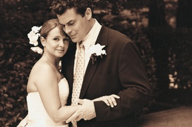 Sepia tone picture of bride and groom embracing