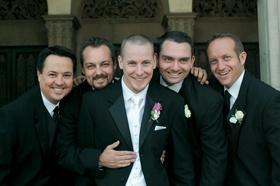 Groom with four groomsmen in black suits