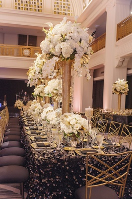 renaissance hotel cincinnati wedding gold chameleon chairs with black cushions, sequin black linens