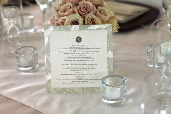 Wedding reception menu with a tropical leaf border