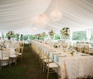 tented wedding reception on lawn of plantation
