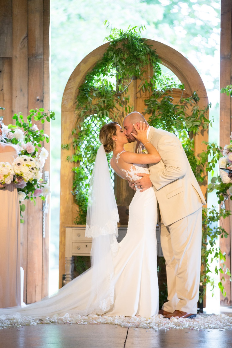 new york jets brian winters wedding, groom in tan suit, bride in pronovias wedding dress, kiss