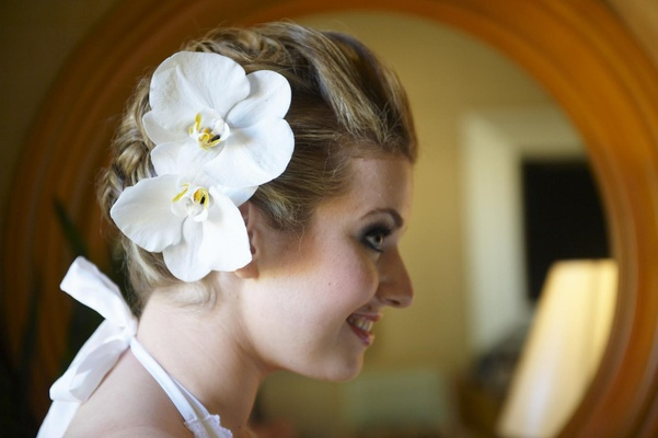 Bride with updo and white orchid hair accessories