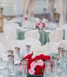 Red and pink rose centerpiece with calligraphy table name