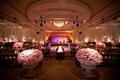 Purple lighting on dance floor and pink flowers