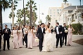 Bridesmaids in light pink dresses and groomsmen in tuxedos in Santa Monica by Casa Del Mar beachfron