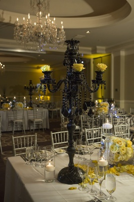 Yellow and black wedding with crystal candelabra painted black