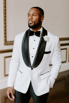 r&b singer tank wedding, white tuxedo jacket with black lapels and pants