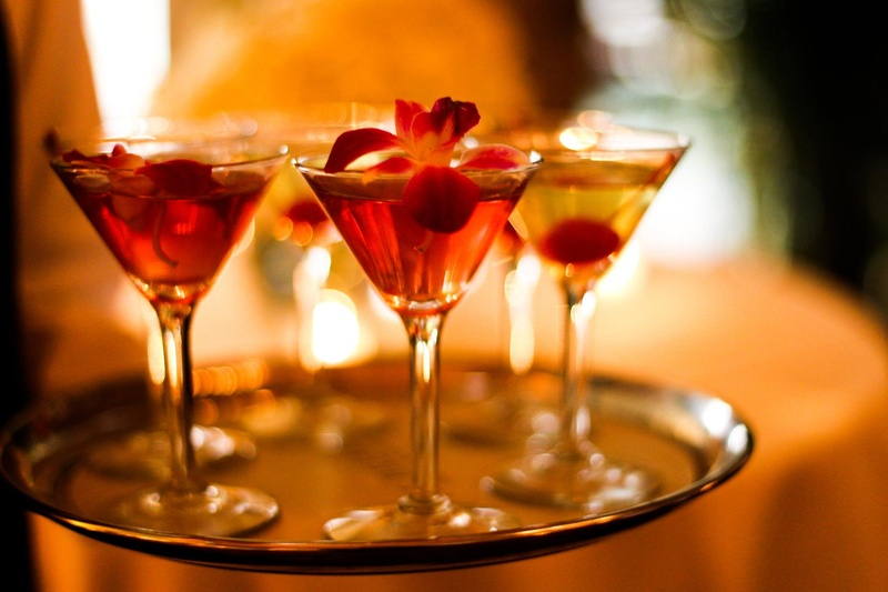red and yellow drinks served in martini glasses