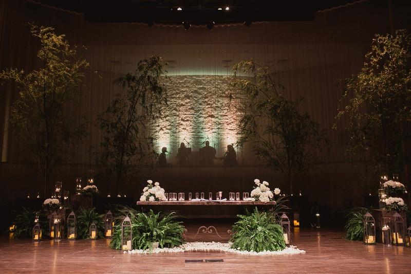 dark wedding ceremony church with trees brought into church wedding
