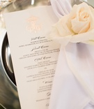 wedding reception place setting menu card rose gold foil monogram napkin white ivory rose