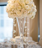 wedding reception flower arrangement white rose hydrangea cascading orchids