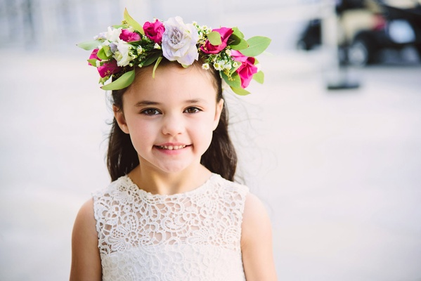 Flower girl in white flower girl dress with flower crown lavender pink white flowers and green leave