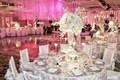 White tables and chairs with pink crystal strands