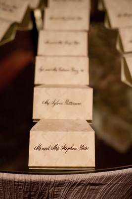 Ivory seating cards with tan flower motif