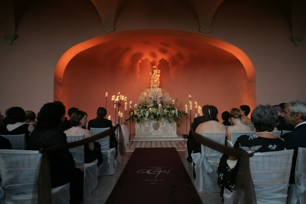 Dramatic candlelit wedding with custom aisle runner